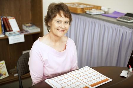 front desk: Friendly, smiling store clerk sitting at the front desk.