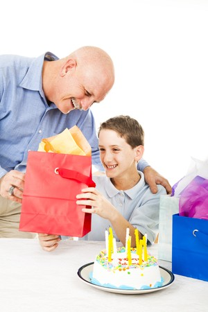 gives: Father gives a birthday gift to his young son.  White background.