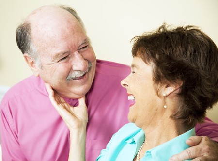 Beautiful senior couple in love, sharing a laugh together.   Stock Photo - 7537821