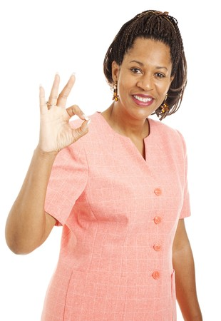 cornrows: Beautiful african-american businesswoman giving the okay sign.  Isolated on white.   Stock Photo