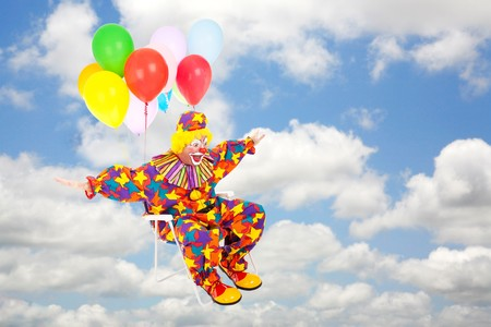 Clown flies through a blue cloudy sky with balloons tied to his lawn chair.   photo