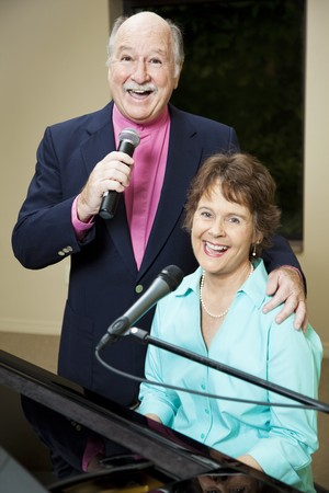vocals: Senior couple enjoys performing vocals and piano together.