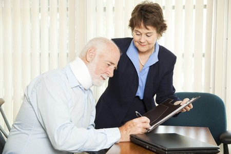 personal finance: Personal injury lawyer signs up a new injured client.