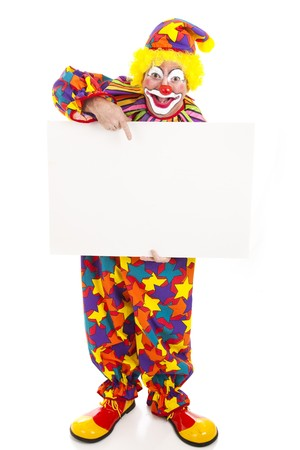 clown's nose: Full body isolated view of a friendly circus clown holding a black white sign.