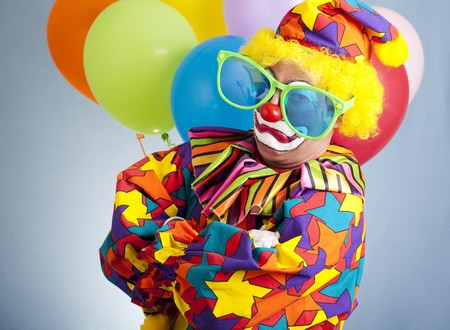 oversized: Funny clown with oversized glasses making a gangsta pose.   Stock Photo