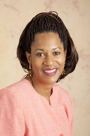 cornrows: Headshot portrait of a beautiful african american businesswoman.