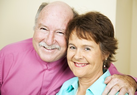 late fifties: Portrait of happy, loving couple in their late fifties.