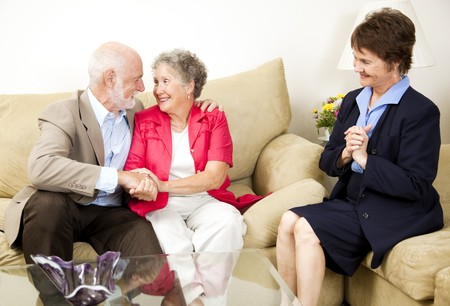 psychotherapy: Happy senior couple benefits from marriage counseling.