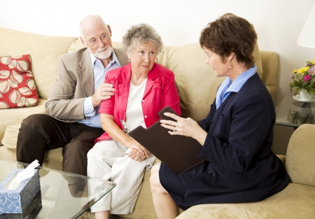 Senior couple meets with a marriage counselor.   photo
