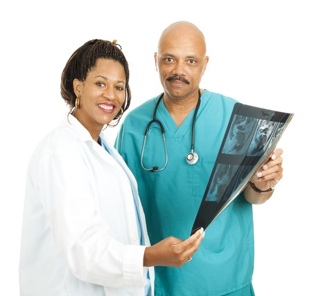 compassionate: Caring, compassionate African American medical doctors.  Isolated on white.
