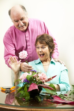gets: Woman arranging flowers gets a surprise gift from her husband.