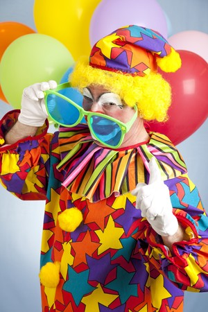 oversized: Funny hip hop clown with oversized shades shaking his finger.