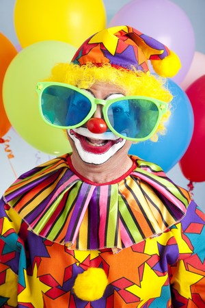oversized: Funny birthday clown wearing over-sized novelty sunglasses.