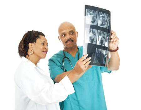 Two doctors reviewing a patient's x-ray results.  Isolated on white.   Stock Photo - 7979331