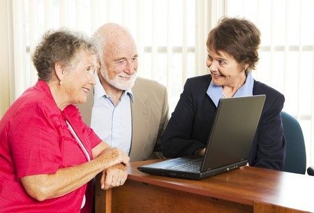 persuade: Persuasive sales woman pitches financial services to an elderly couple.