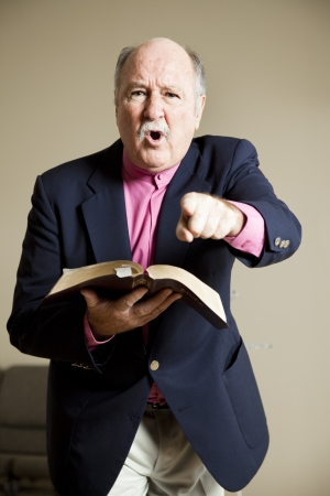 religious service: Angry preacher gives a fiery sermon in church.   Stock Photo