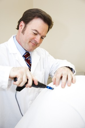 Chiropractor using an electric tool to adjust a patient's spine. Stock Photo - 8172049