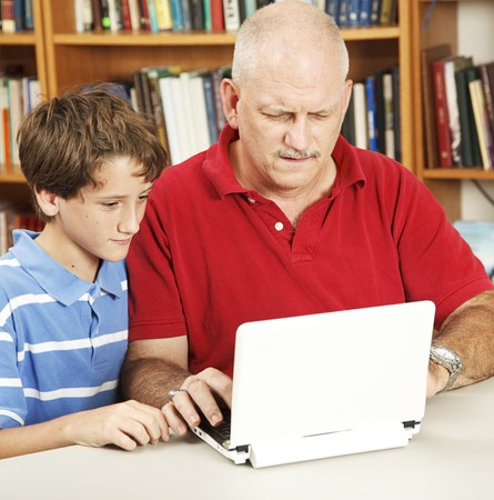 Confused father tries to help his son do homework on the netbook computer.   Stock Photo - 8174652