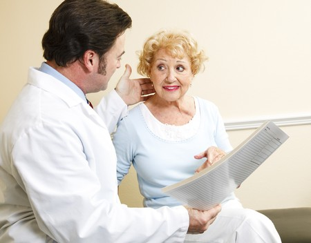 Chiropractor/doctor discussing treatment options with a beautiful senior patient. Stock Photo - 8172050
