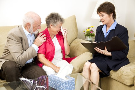 mortician: Therapist helps a senior woman suffering from depression.  Could also be grief counseling. Stock Photo