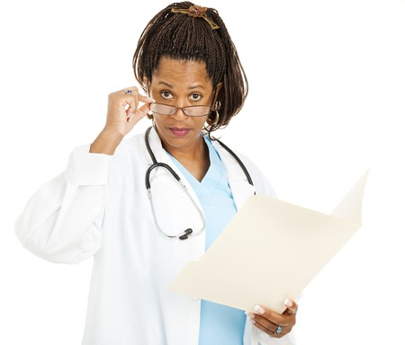 opthalmology: Skeptical female doctor, holding a chart, looks over her glasses at you.  Isolated on white