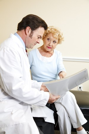 Chiropractor and his patient reviewing her medical history together. Stock Photo - 8240749