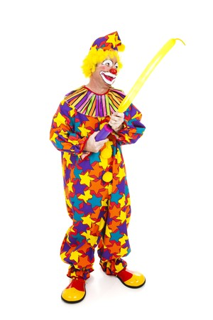 Clown blows up a special balloon for making balloon animals.  Full body isolated on white.   photo