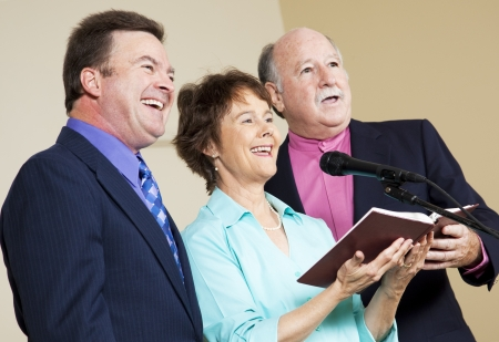 hymnal: Three singers performing from the church hymnal.