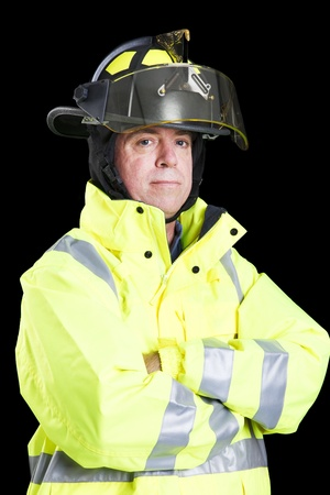 protective: Portrait of handsome firefighter taken against a black background.