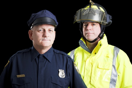 Police officer and fire fighter portrait on black.