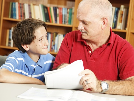 School boy listens to his teacher (or dad) with a skeptical expression. Stock Photo - 8240790