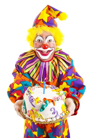 Colorful clown holding a birthday cake.  Isolated on white.   photo