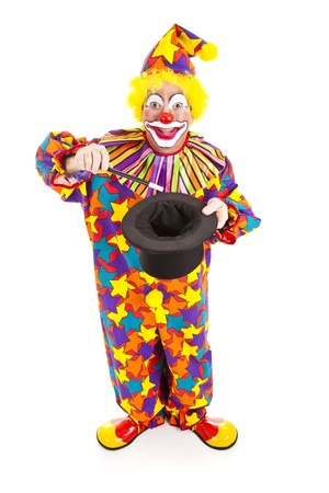 magic trick: Birthday clown does a magic trick.  Full body isolated on white. Stock Photo