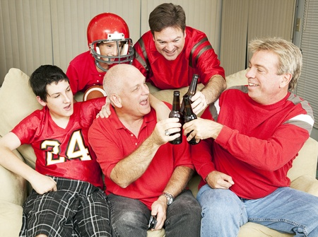 Superbowl football fans toasting success with their beer bottles.   photo