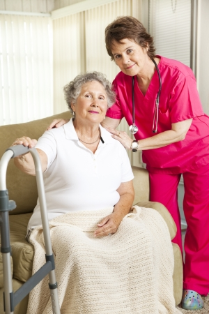 Dignified senior woman in a nursing home, with a caring nurse.