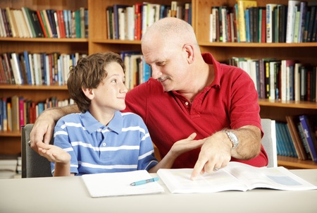 Teacher or parent working with a young boy who has learning disabilities. Stock Photo - 8627860