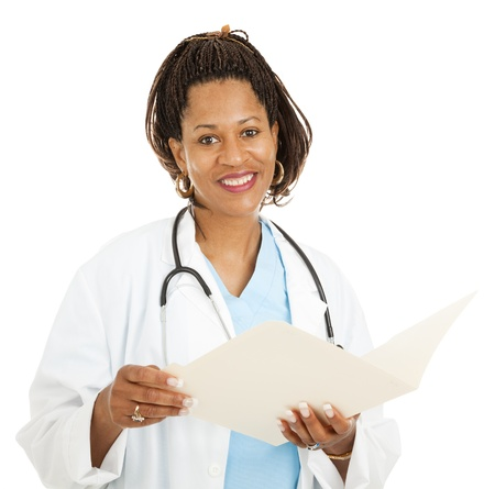 female surgeon: Beautiful african-american female doctor reading a patients medical chart.  Isolated on white.
