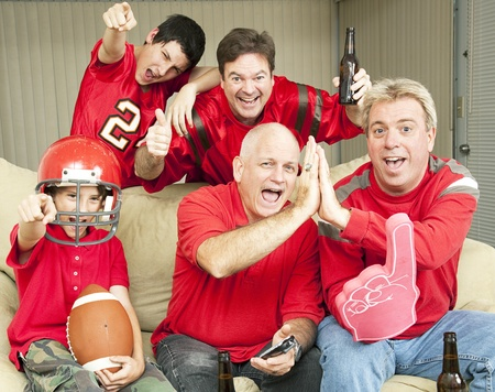 football fan: American football fans get together for a super bowl party.