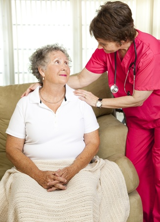 home health care: Nurse helps senior woman.  Could either be in-home care or at a nursing home or assisted living facility.