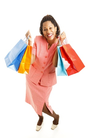 Excited african-american woman, holding shopping bags.  Full body isolated on white.   photo