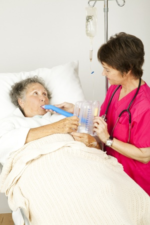 recovering: Nurse gives respiratory therapy to a patient recovering in the hospital.
