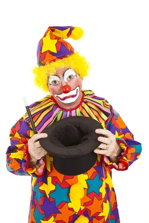 Sad birthday clown lost his bunny in the magic top hat.  Isolated.   photo