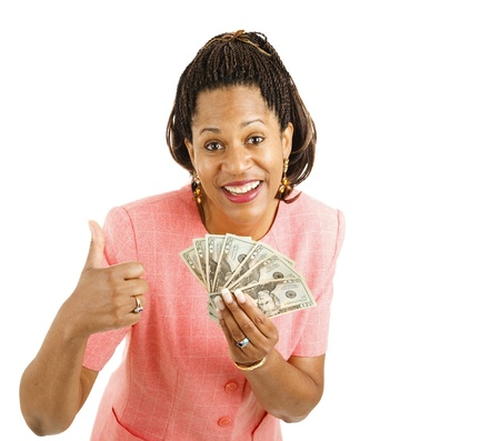 Beautiful African-american businesswoman holding a hand full of cash and giving a thumbsup sign.  Isolated on white photo