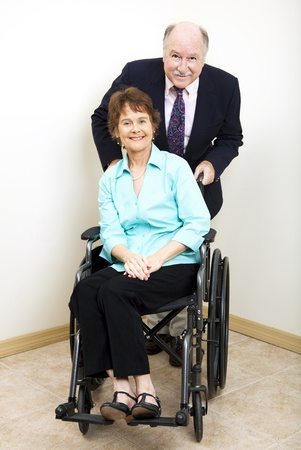 Disabled businesswoman and her male business partner.   photo