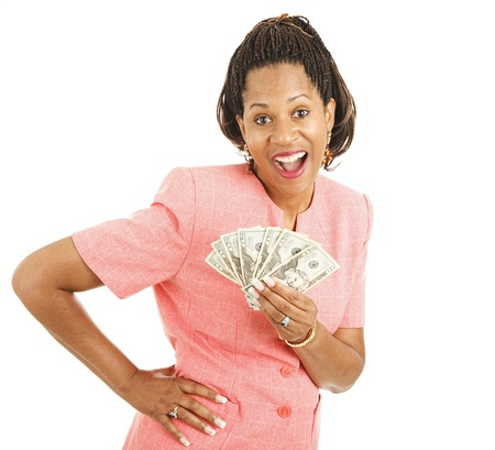 Pretty african-american woman has just won a lot of cash money.  Isolated on white.   photo