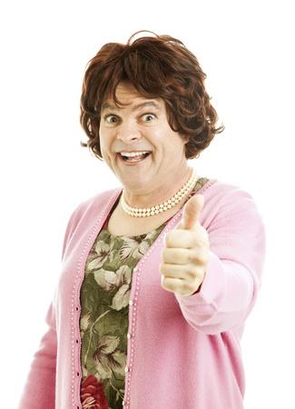transvestite: Humorous poto of cross-dressing transvestite giving a thumbsup sign.  Isolated on white.
