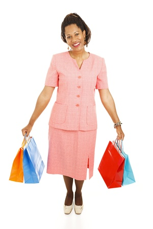 Happy african-american woman with her shopping bags.  Full body isolated on white   photo