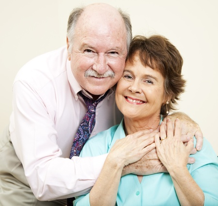 Loving portrait of good looking couple in their early sixties. Stock Photo - 8869225