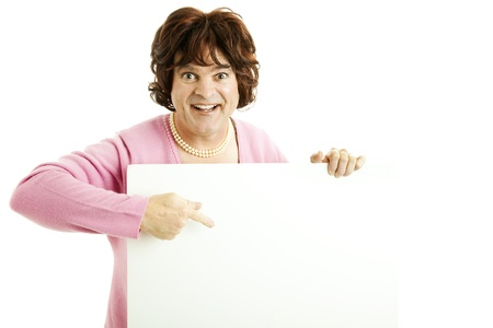 Man dressed as woman points enthusiastically to blank white sign.  Isolated on white.