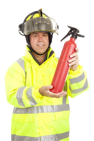 Fire fighter demonstrating how to use a fire extinguisher.  Isolated on white.   photo